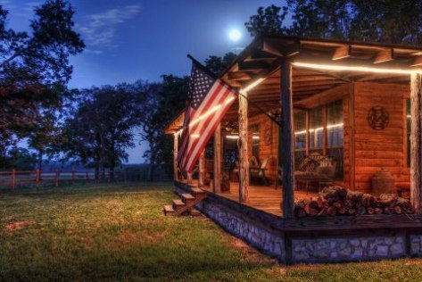 Night on the porch as the moon slips across the sky