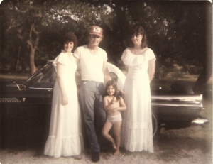 Roger Guinther with Tracye, Mandy and Jolene in front of his 57 T-Bird.
