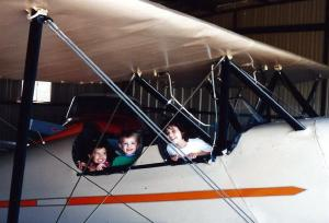 Katrina, Storm and Jackson hanging out in one of Poppy's planes.