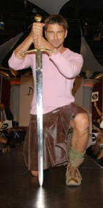 Gerald Butler in pink with a leather kilt.