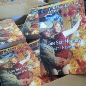 Harlequin sent me a box full of my books today.