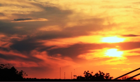 Sunset over Castroville during at a high school football game.