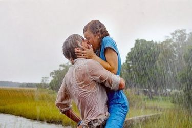 Kissing in the rain including clingy white shirt in Notebook