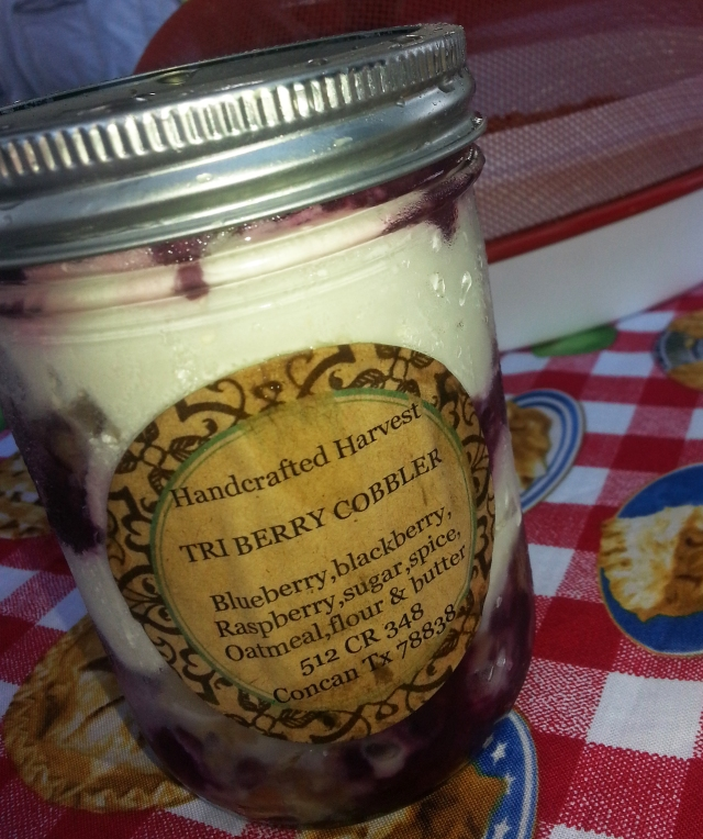 Fresh berries and cream for dessert in a jar.