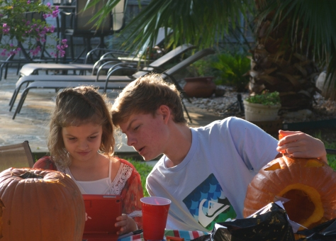 Cousins helping with the pumpkins
