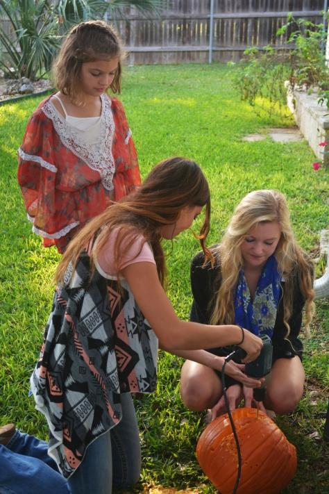 Girls using powertools to carve