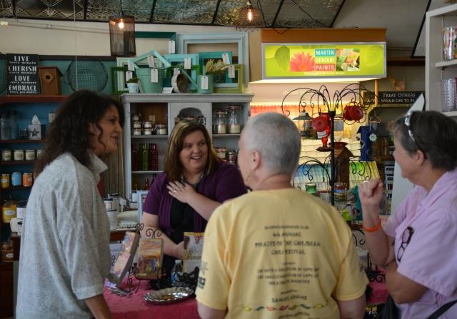 Jolene Navarro signing books at Bergmann Lumber